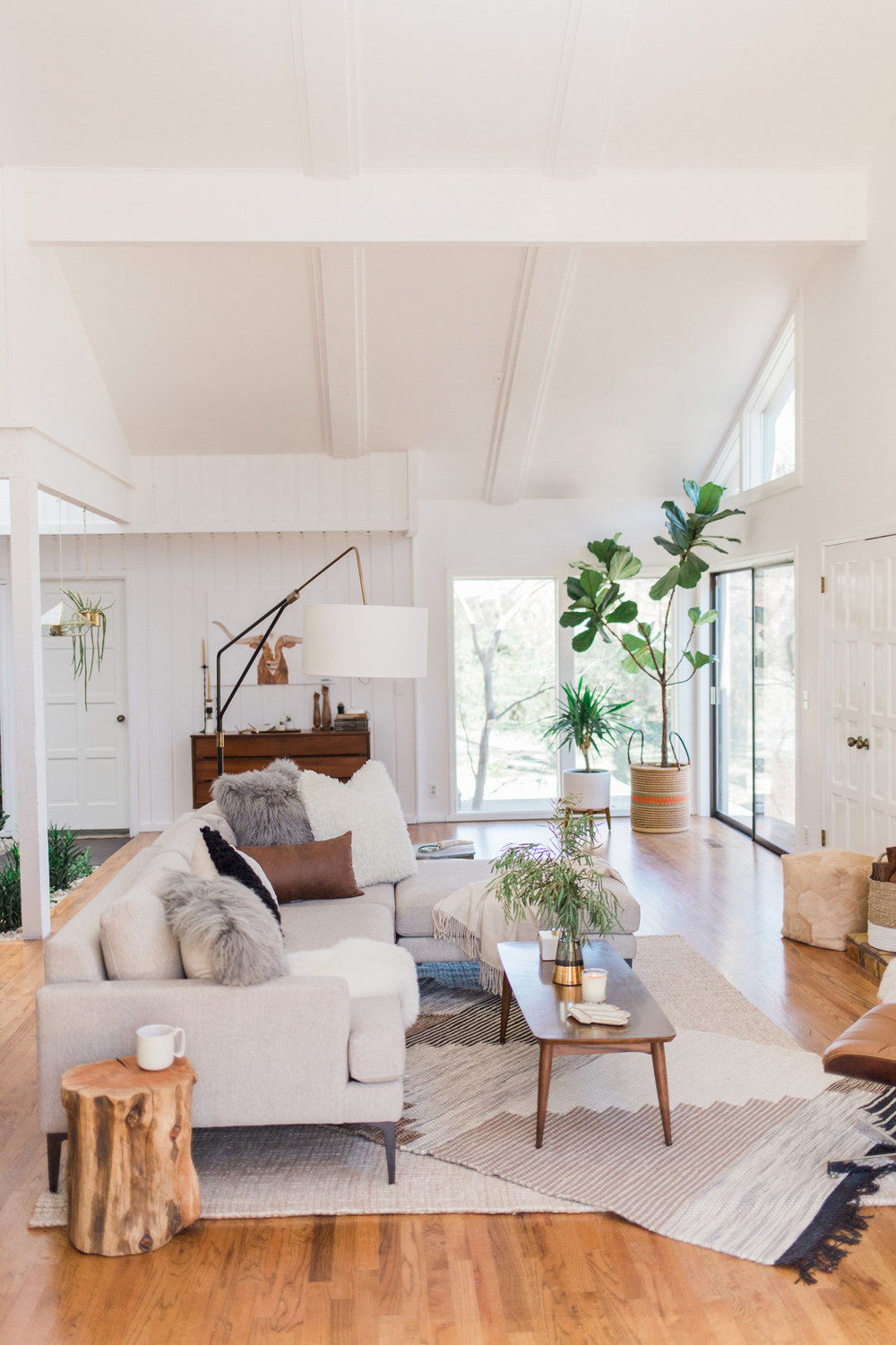 Get the look of this neutral California eclectic living room on the blog! This room does neutrals right - varying the texture and patterns, but keeping the color palette quiet overall.