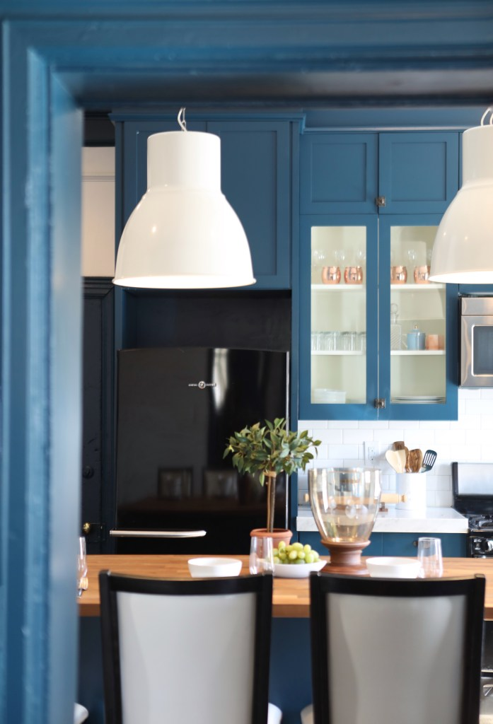 Old Home Love's One Room Challenge Fall 2017. I love this blue kitchen with the modern white pendant lights over the butcher block counters!
