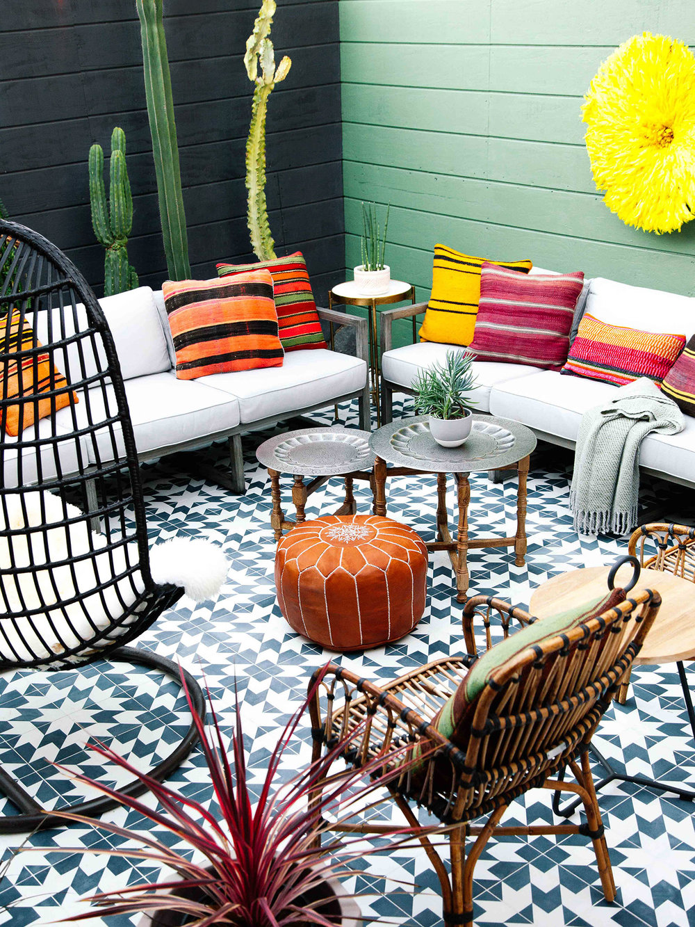 Old Brand New's eclectic boho outdoor patio makeover from the One Room Challenge (Fall 2017). I love the bright colors, planked walls, and Moroccan inspired tile!