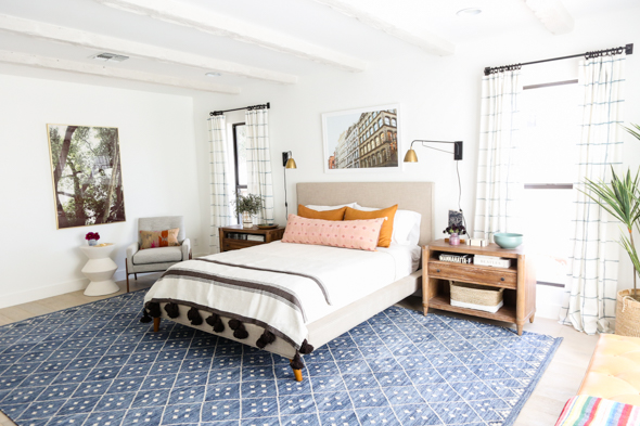 Little Green Notebook One Room Challenge Fall 2017. Gentry project bedroom is one of my favorite room makeovers! I love the mix of styles, and that big blue rug is amazing! The grid pattern curtains were a DIY.
