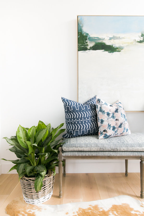 Inspiration for Mix & Match Design Company's One Room Challenge (Spring 2018). I'm loving the mix of styles, the blue and green color scheme, and that large abstract landscape painting.
