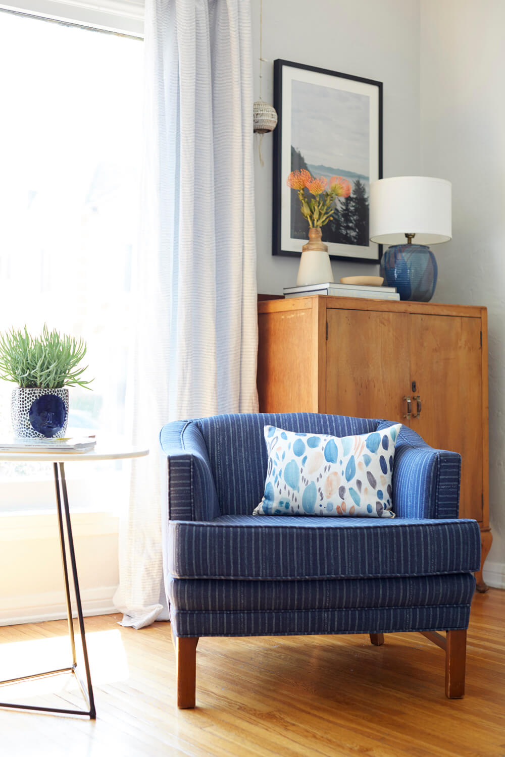 Inspiration for Mix & Match Design Company's guest room makeover for the One Room Challenge. Love the mix of old and new in this living room. The blue striped chair plus the antique cabinet in the corner is perfection!