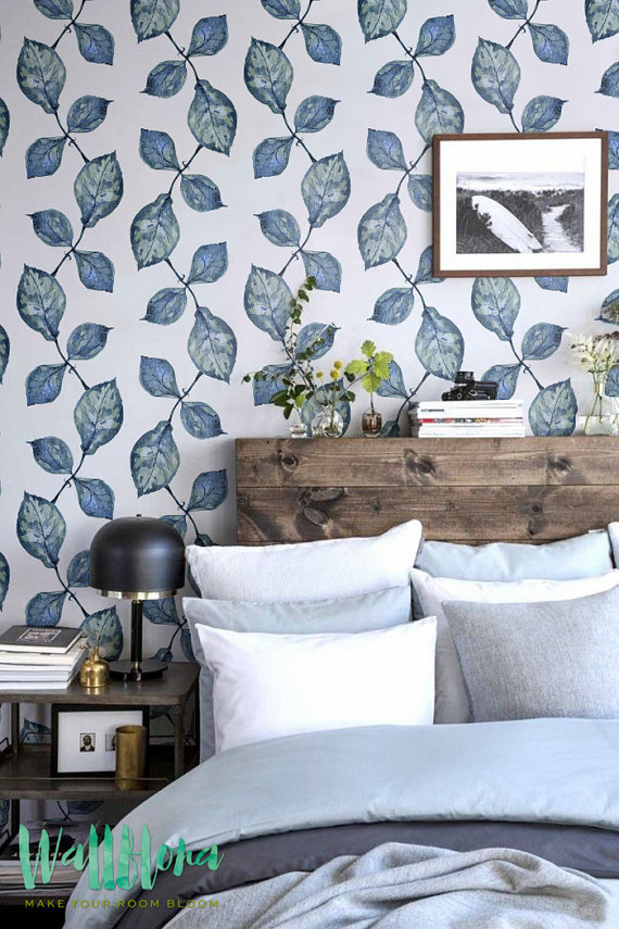 Inspiration for Mix & Match Design Company's guest bedroom makeover for the One Room Challenge. Loving the mix of blue bedding, blue-green floral wallpaper, and the warm wood headboard.