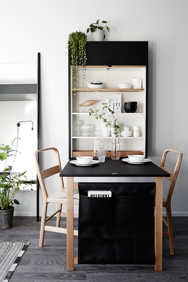 If you live in a small house or apartment, it can be tricky to find a spot for a dining table. Learn how to make a dining area (like using a fold down table!) in a small home in this blog post!