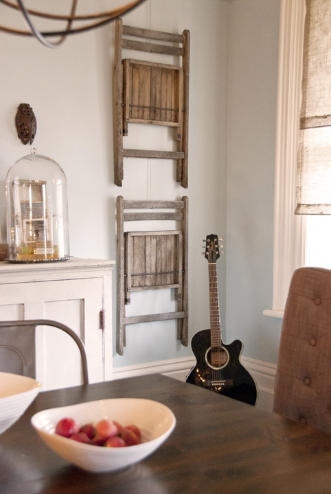 Need extra dining chairs, but don't have anywhere to store them? Hang the chairs on the wall! See more clever small space solutions on the blog.