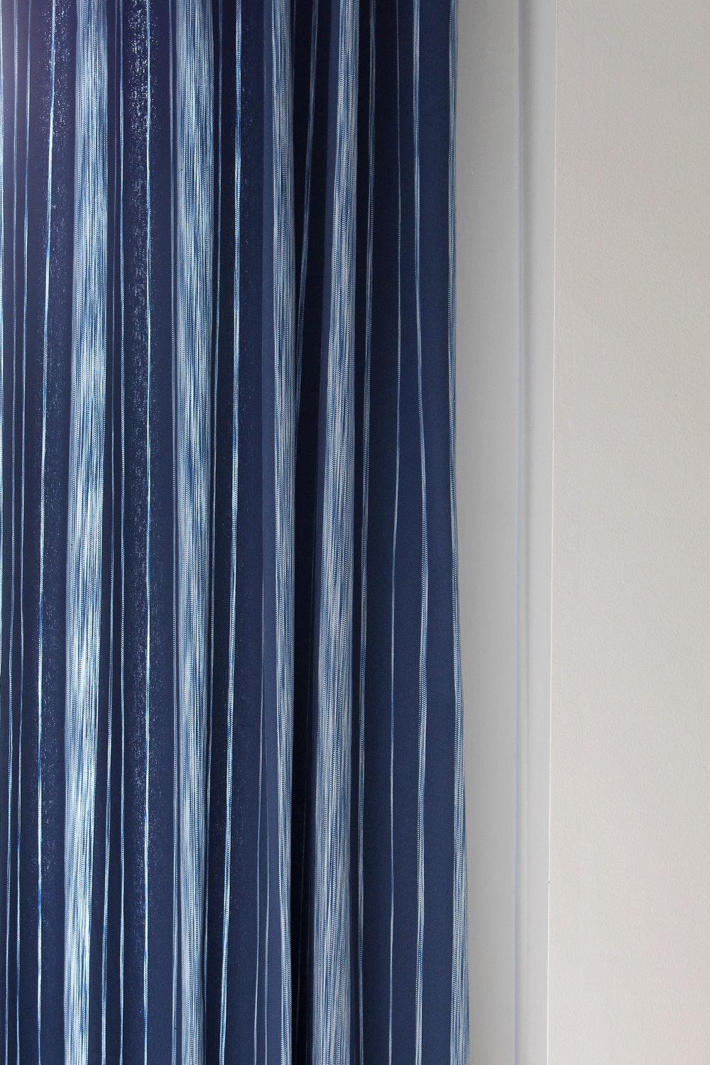 Close up of the Pizzelle Navy fabric from Calico's Vern Yip collection. See it here as a made into a beautiful curtain panel in this guest room.