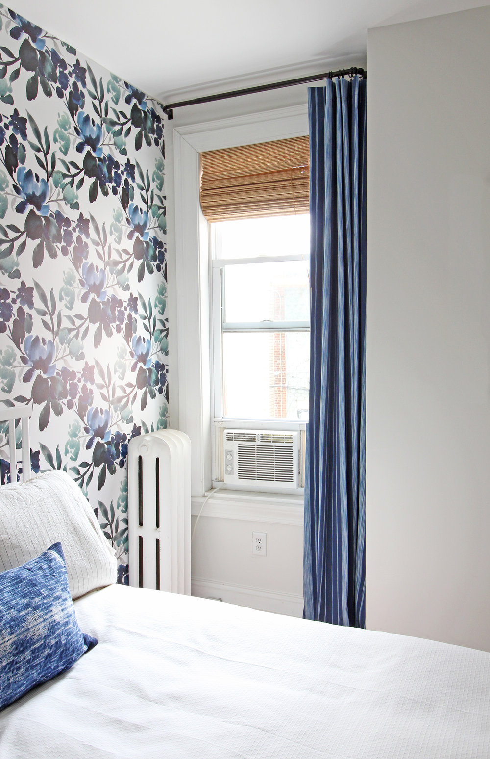 Here's a peek of the progress on this One Room Challenge Guest room! A new blue striped curtain went up this week (custom made) along with a woven roman shade. These complement the bold blue and green floral wallpaper beautifully.