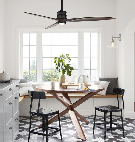Need a ceiling fan? Don't sacrifice style for function. There are lots of great options out there these days - come read about how to pick the right ceiling fan out. || Modern breakfast nook with ceiling fan