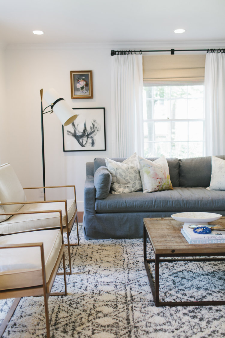 Buying a sofa soon? There's a lot to think about! Here's a guide to helping you think through how to find the perfect couch for your home. // gray slipcovered sofa, how to pick a sofa, shopping for a sofa, sofa buying tips.