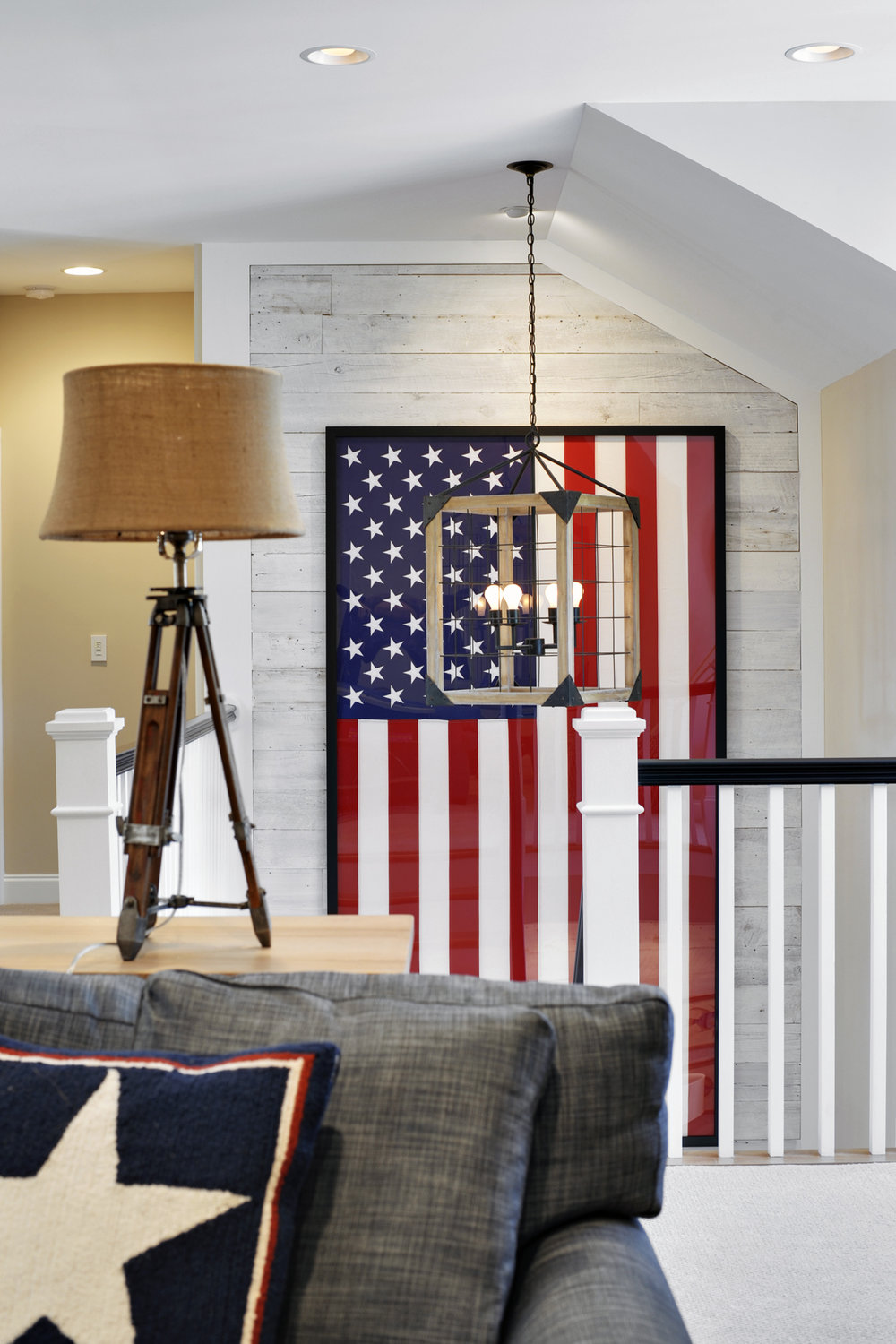 Using American flags as decor. A black frame gives this flag a modern feel against the whitewashed barn wood wall.