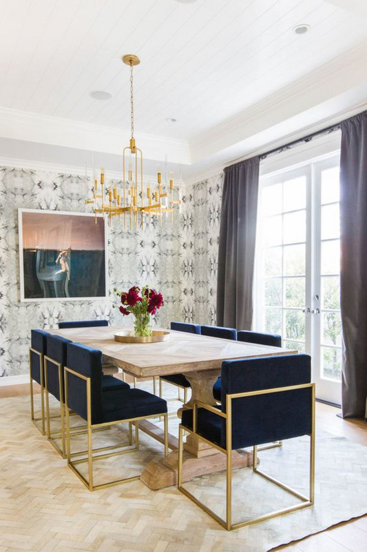 Inspiration for a fresh classic dining room with a touch of glam. Love the modern brass dining chairs paired with the farmhouse table. The wallpaper is super fun too!