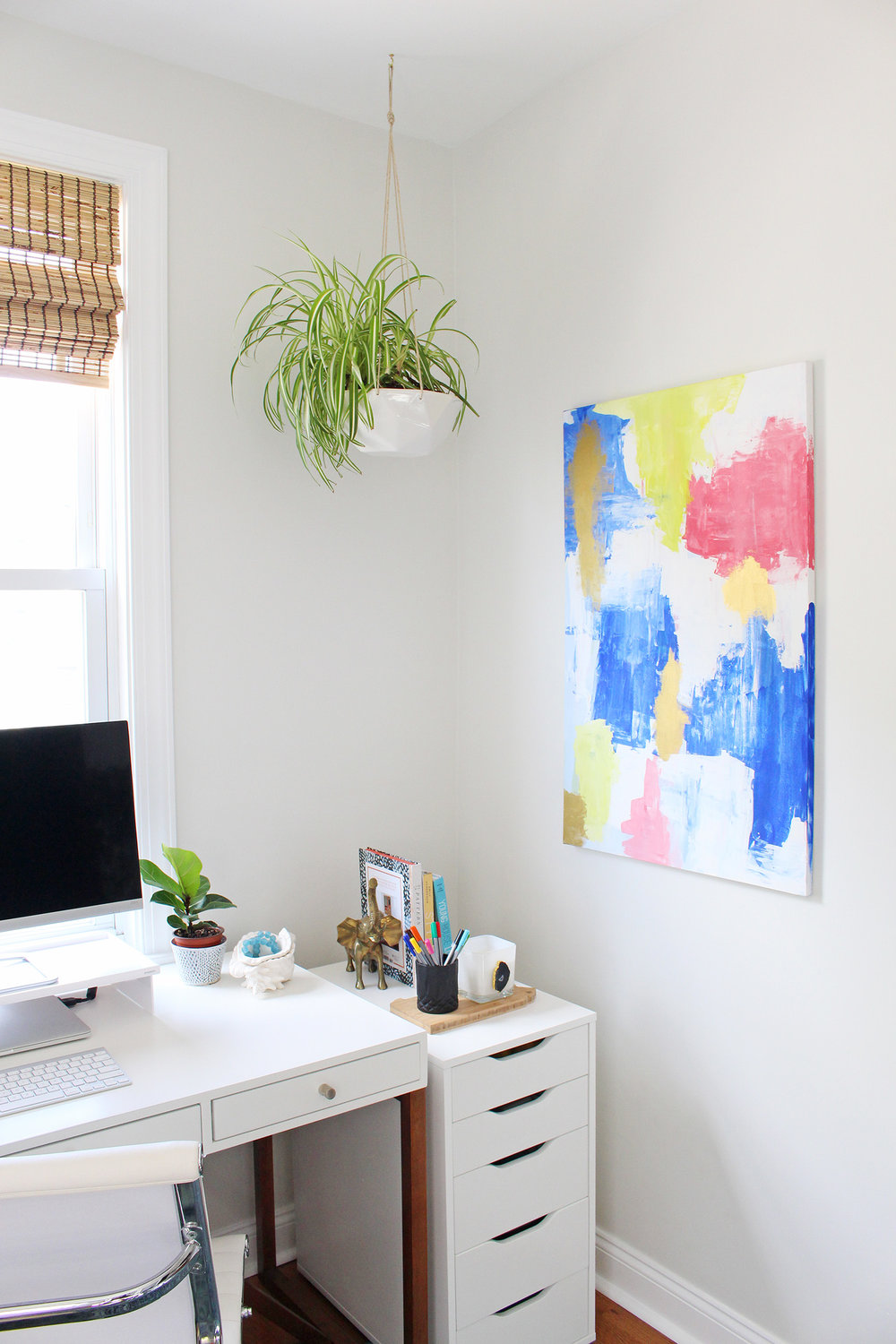 Use a hanging planter to fill an empty corner in your home. This white geometric planter from Convivial Production was a perfect fit for the corner of my office.