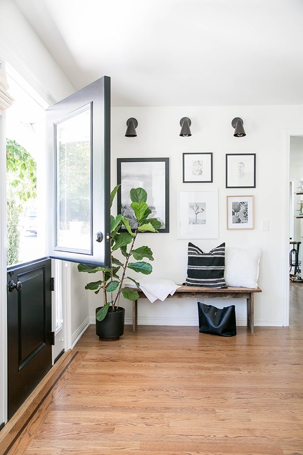 A simple bench with a gallery wall above makes for a perfect entryway and a great drop zone. For more ways to use benches in your home, check out this blog post!