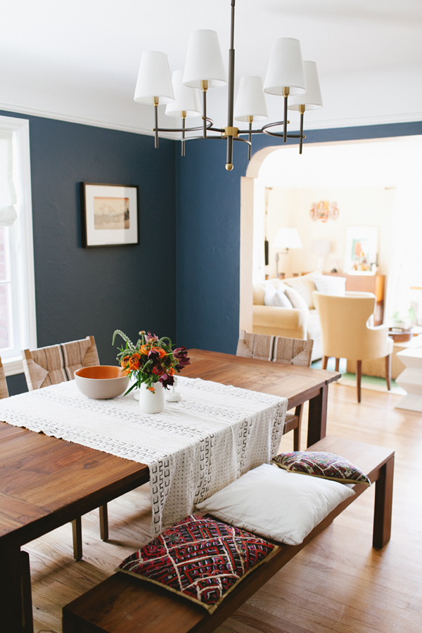 A bench mixed with chairs works beautifully in this blue dining room. For more ways to use benches in your home, head to this blog post!