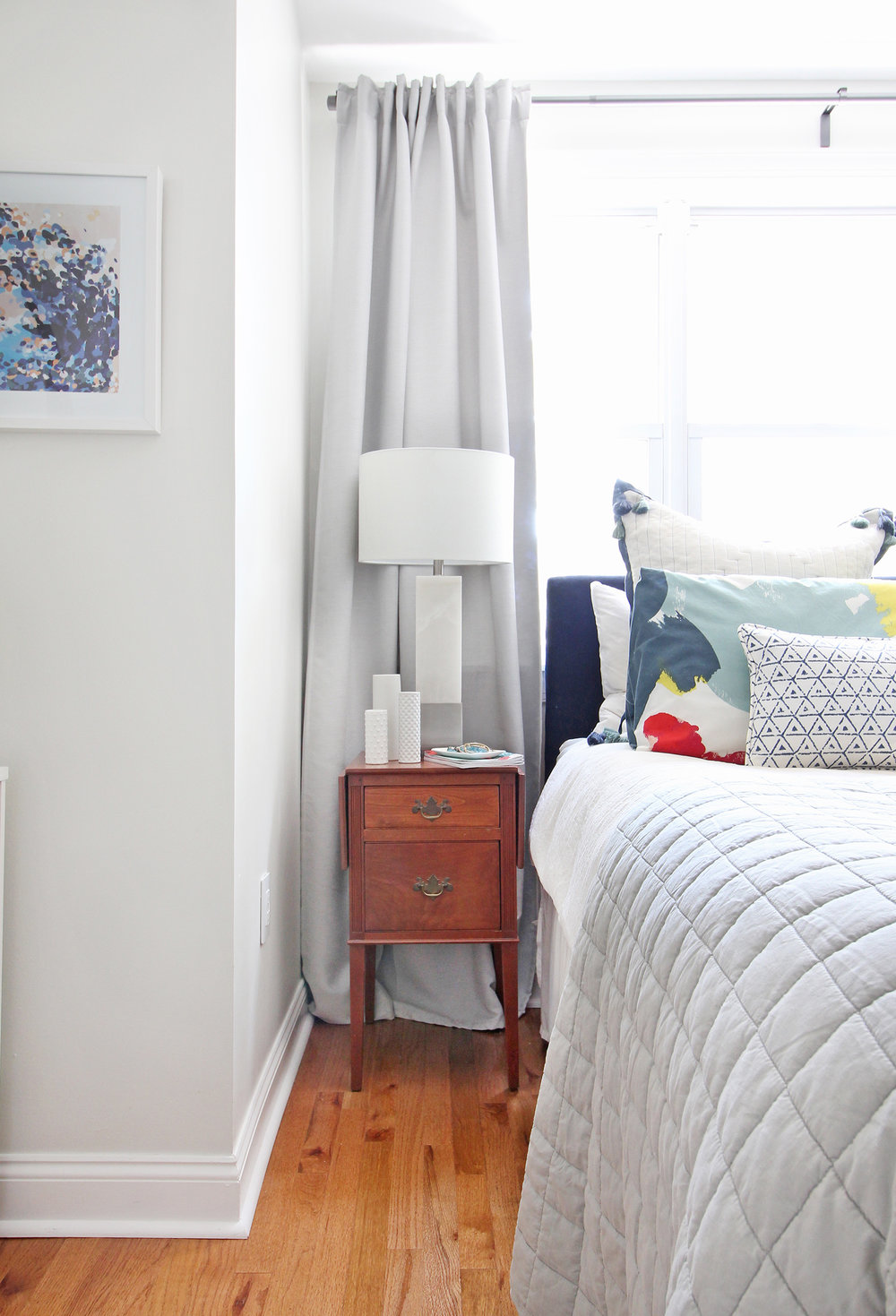 Head to the blog to check out Mix & Match Design Company's mini refresh of her eclectic modern master bedroom. Mixing old and new is one of her favorite things to do. She inherited a pair of traditional nightstands from her grandmother and topped them with modern marble table lamps. A gray linen quilt works beautifully with her tasseled euro shams, watercolor shams, and blue and white lumbar pillows.