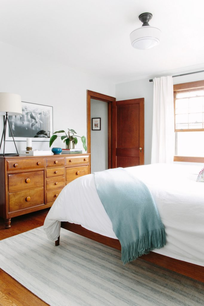 Working with wood trim can be a challenge, but this new traditional style bedroom proves that it can be done well! They mixed old and new beautifully and helped keep things bright with white walls and linens.