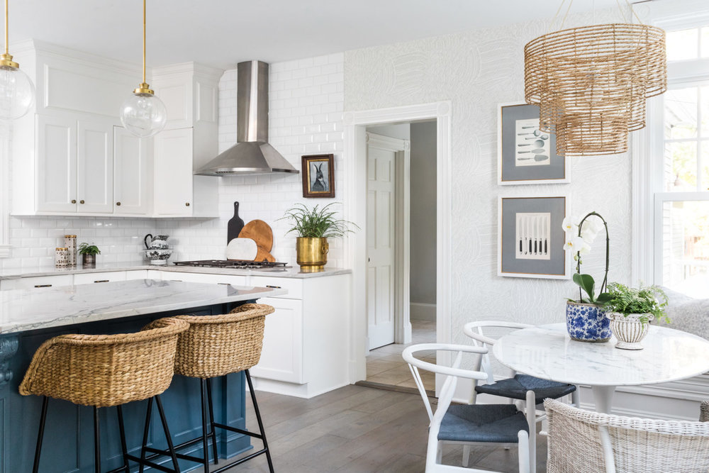 One Room Challenge Fall 2018 | This coastal modern kitchen hits all the right notes with its white and navy cabinets, breakfast nook, and modern lighting.