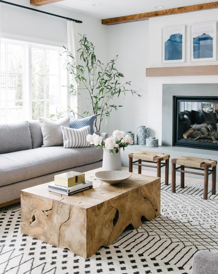 Need help with how to choose a coffee table or ottoman for your living room? I've got you covered! I'll walk you through what you need to think about when you're shopping for one for your home. Plus, I've got a roundup of my favorite coffee tables and ottomans to help you get started in your search. // Modern coastal eclectic living room from Studio McGee.