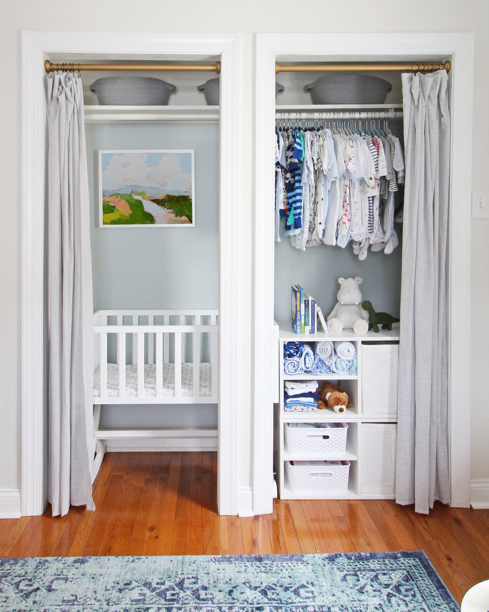 "Come on over to the Mix & Match Design Company blog for this cozy modern nursery nook reveal! This space is shared with a home office and is full of great ideas on how to squeeze in a small nursery into a closet. The ""nursery nook"" concept is perfect if you live in a smaller home. Eclectic Scandinavian blue and white nursery."