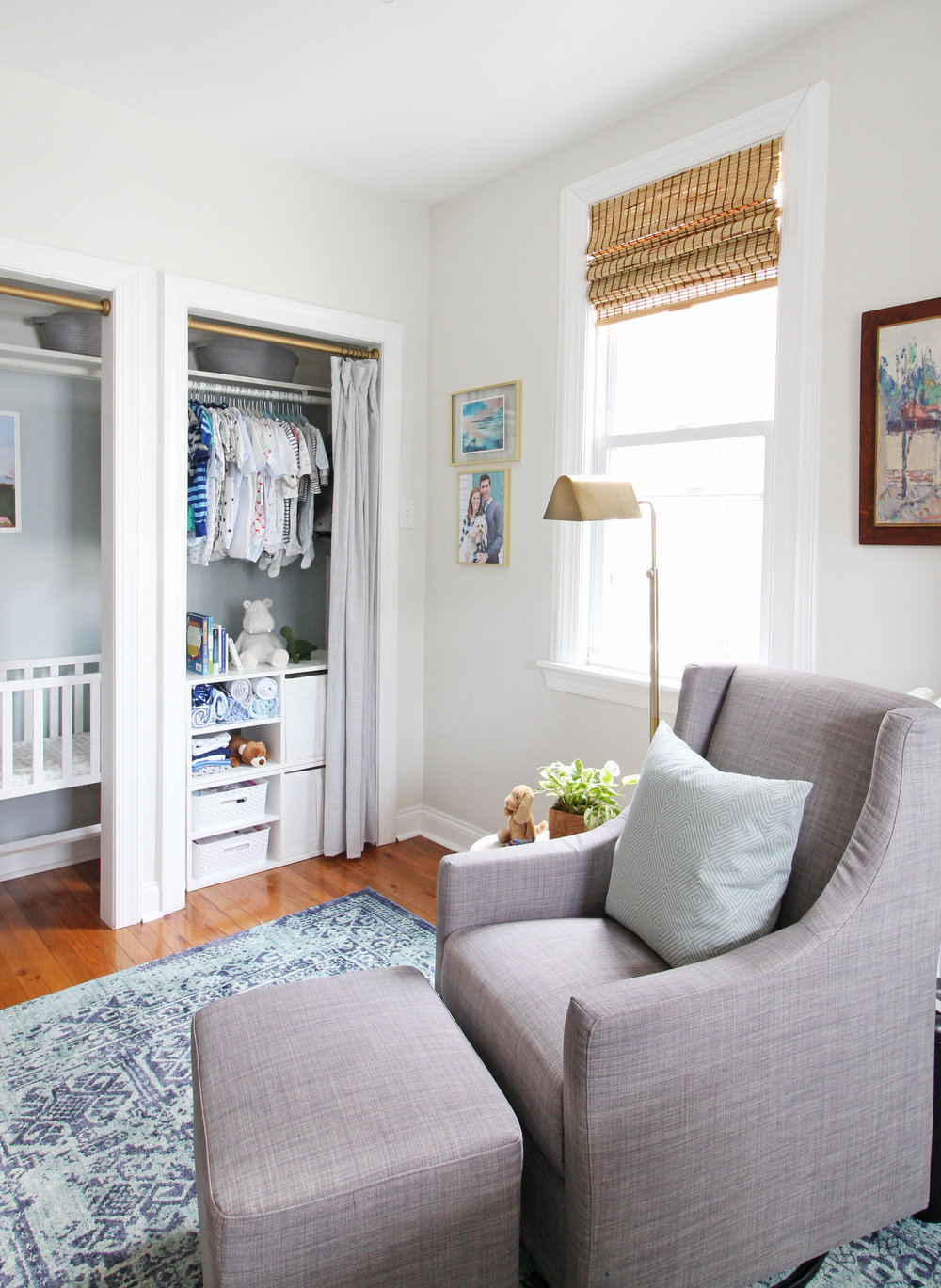 "Come on over to the Mix & Match Design Company blog for this cozy modern nursery nook reveal! This space is shared with a home office and is full of great ideas on how to squeeze in a small nursery into a closet. The ""nursery nook"" concept is perfect if you live in a smaller home. Gray glider in a blue nursery."
