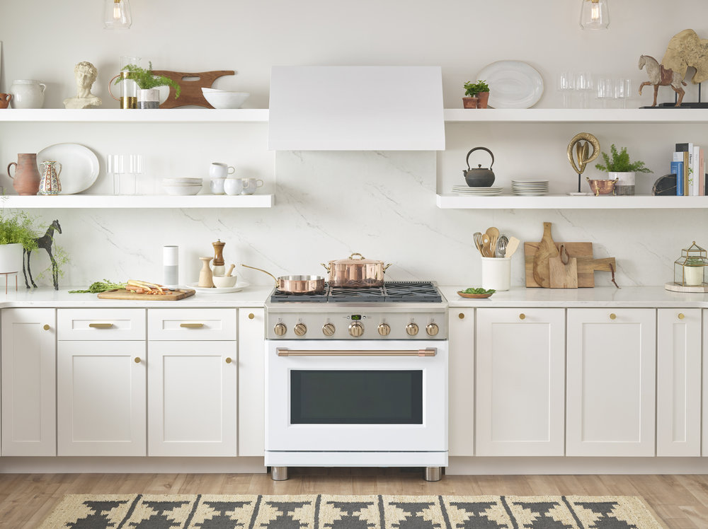 What's your kitchen style? Light and bright, or dark and dramatic? See two examples of these contrasting styles featuring gorgeous matte white and matte black Café Appliances - then weigh in on your favorite! You can find Café Appliances at Gerhard's Appliances if you're local to Philadelphia! // White kitchen with a green island