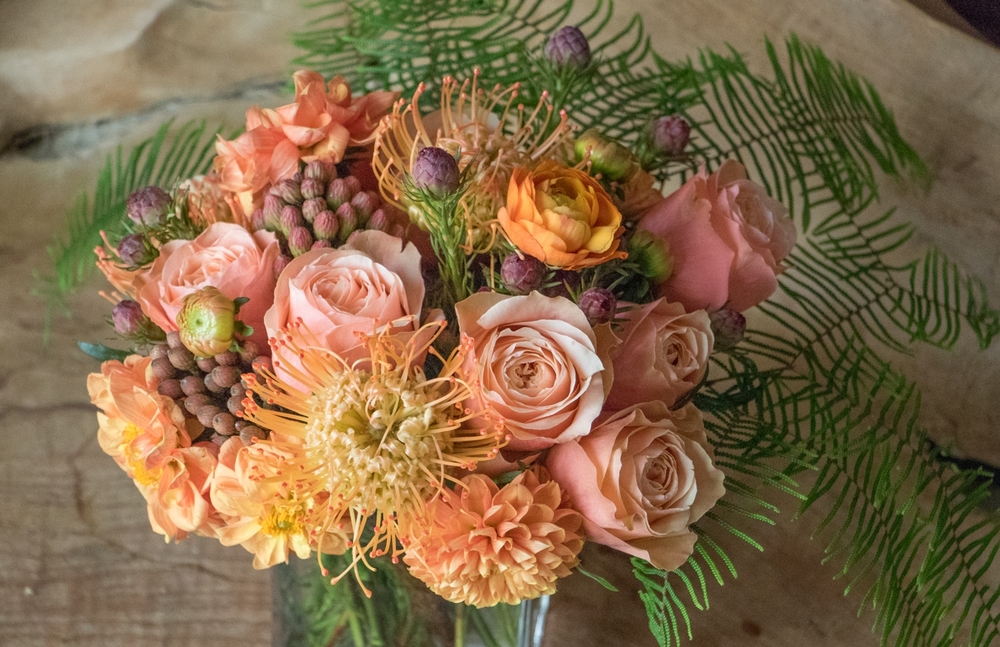 Protea, Rose, Ranunculus, Dahlia, Bridal Bouquet Pebble and Branch Floral