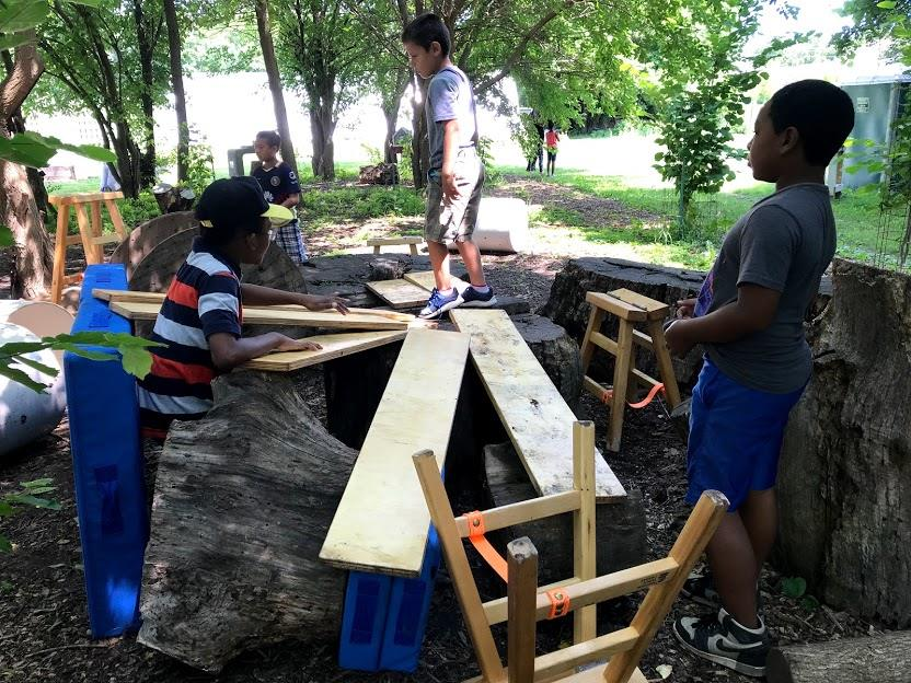 Kids engage with Anji Play materials at Troy Gardens in Madison, WI.