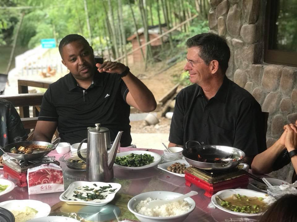 Kaleem Caire, CEO of Anji Play Pilot Partner One City Schools and One City Schools Board of Directors Vice-Chair Joe Krupp, relfect on their experience at Shuangyi Kindergarten over lunch in Shuangyi Village, Anji.