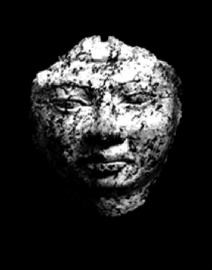 Sculpture of a face carved in pink granite