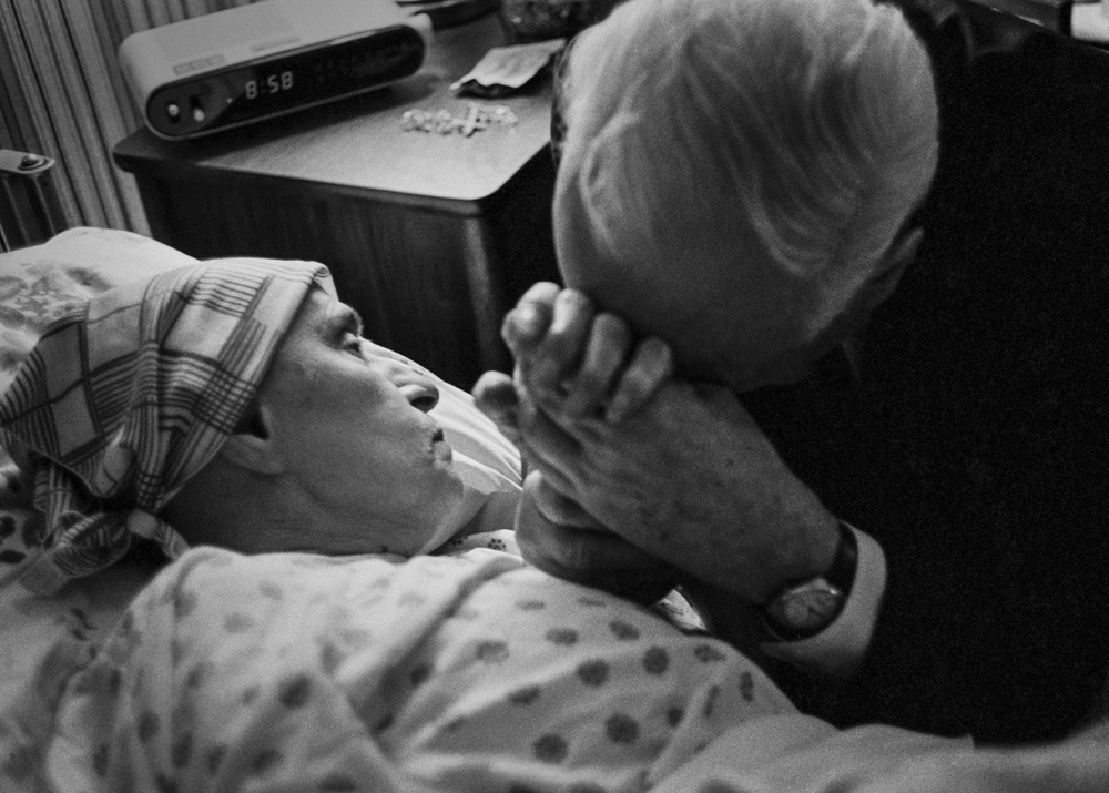 My father saying good-bye to my mother for what he thinks is the last time. Due to her irregular breathing, the hospice staff thought the end was near.
