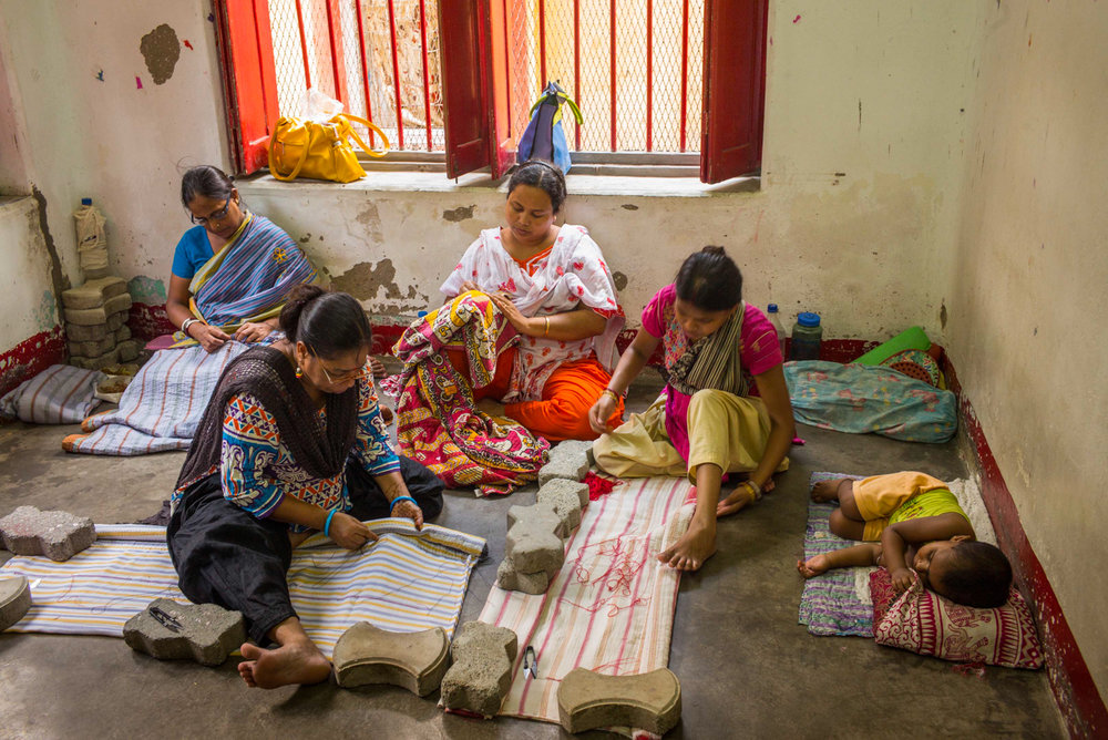 Each day at Sari Bari begins with songs and words of encouragement. The place comes to life when the women start their tasks, sitting on the floor or behind sewing machines.