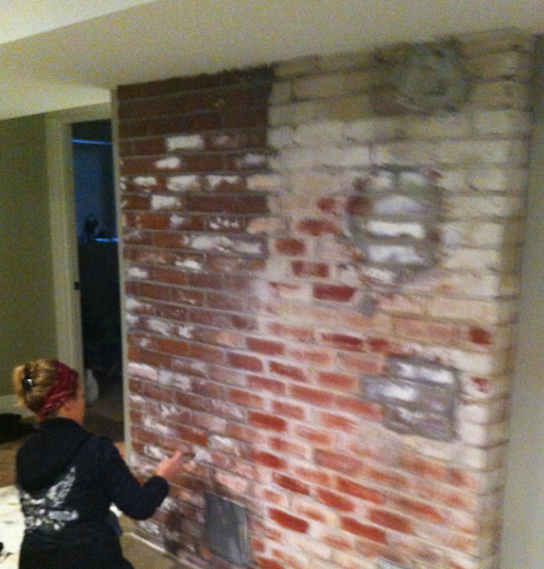 Painted mural on brick fireplace