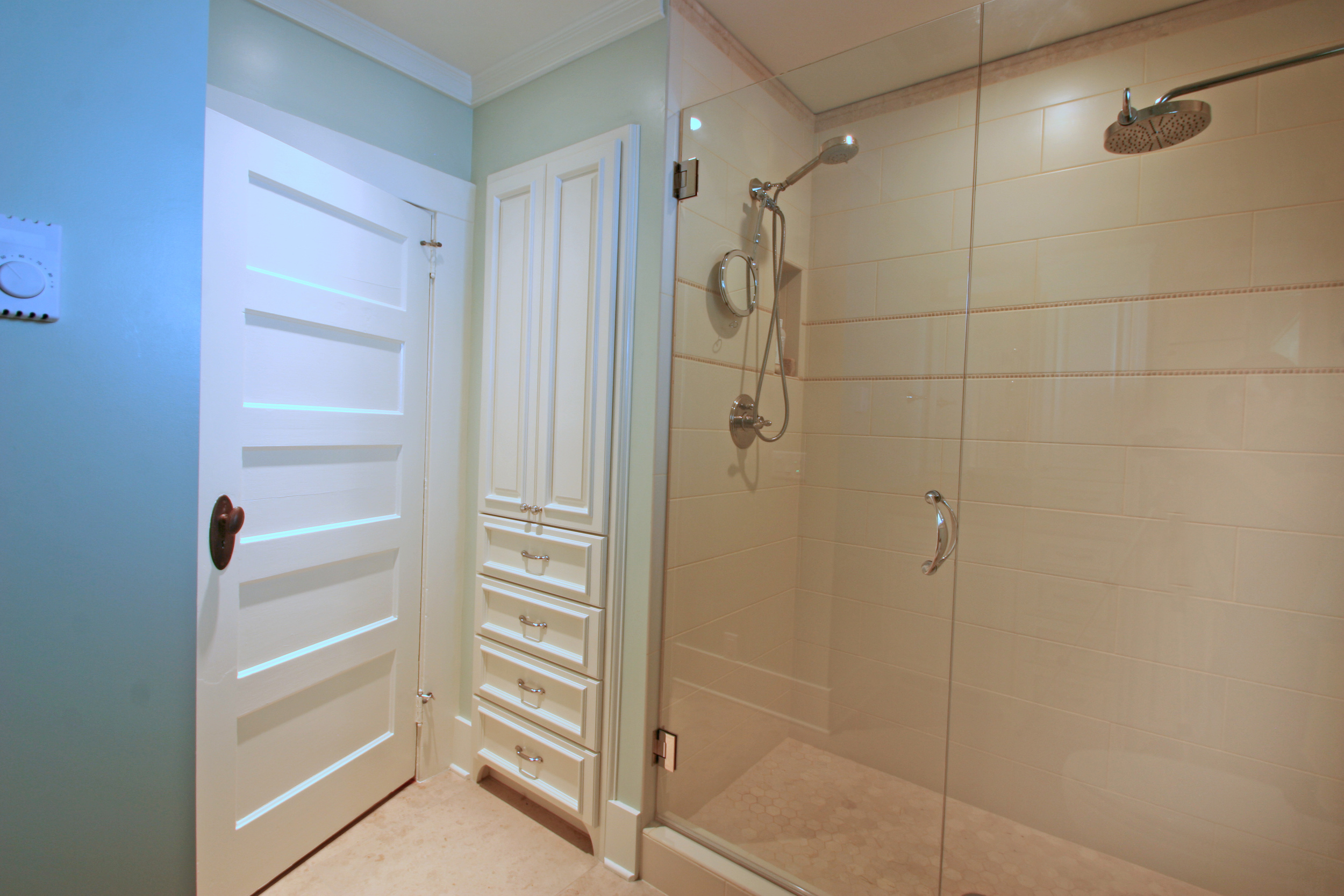storage solutions for bathrooms, linen closets in bathrooms, finished designs by garrison hullinger interior design
