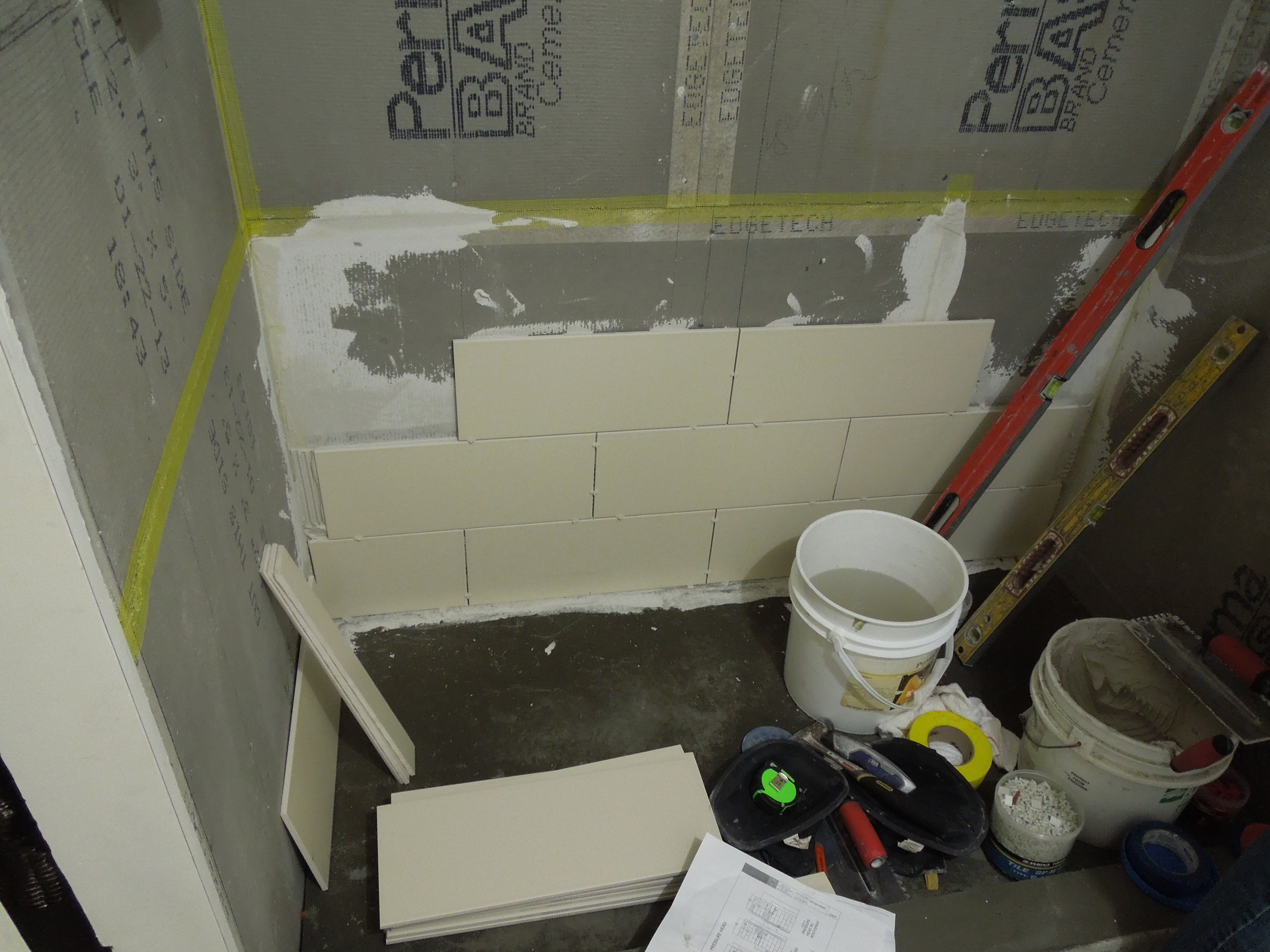 tile layouts for bathroom showers, shower tiles, setting tile in a shower