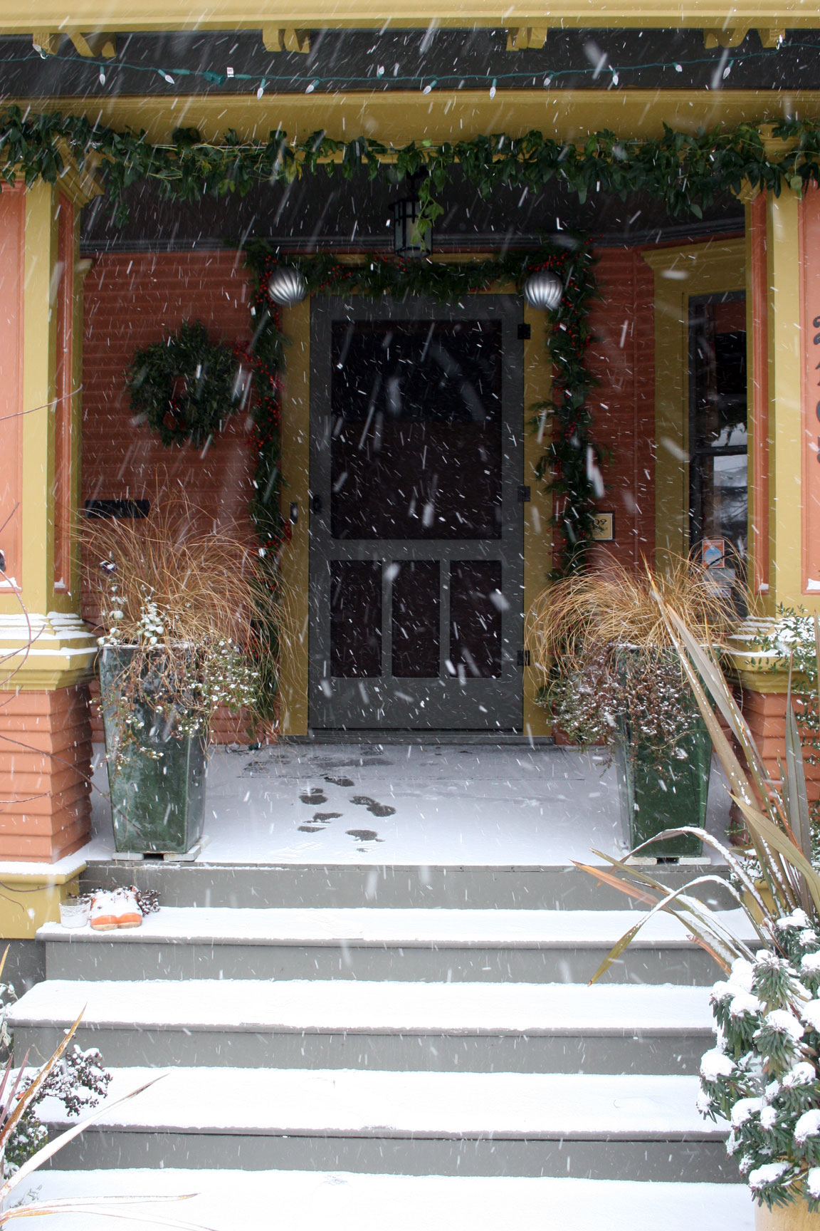 Garrison hullinger, christmas decorations outside, snow on front porch