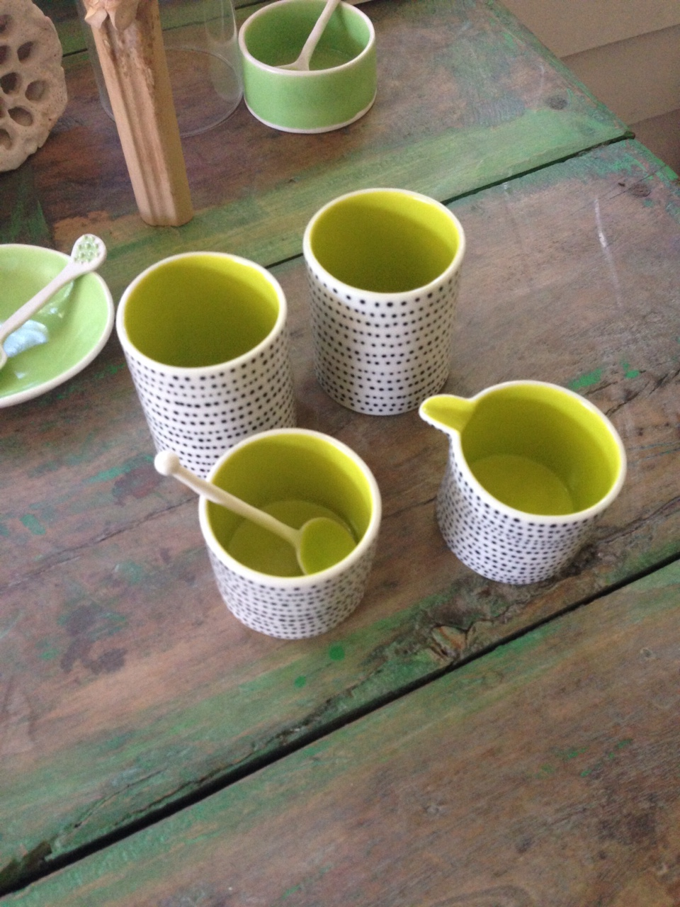 colorful tea sets, hand-made ceramic artwork, bright colored cups,