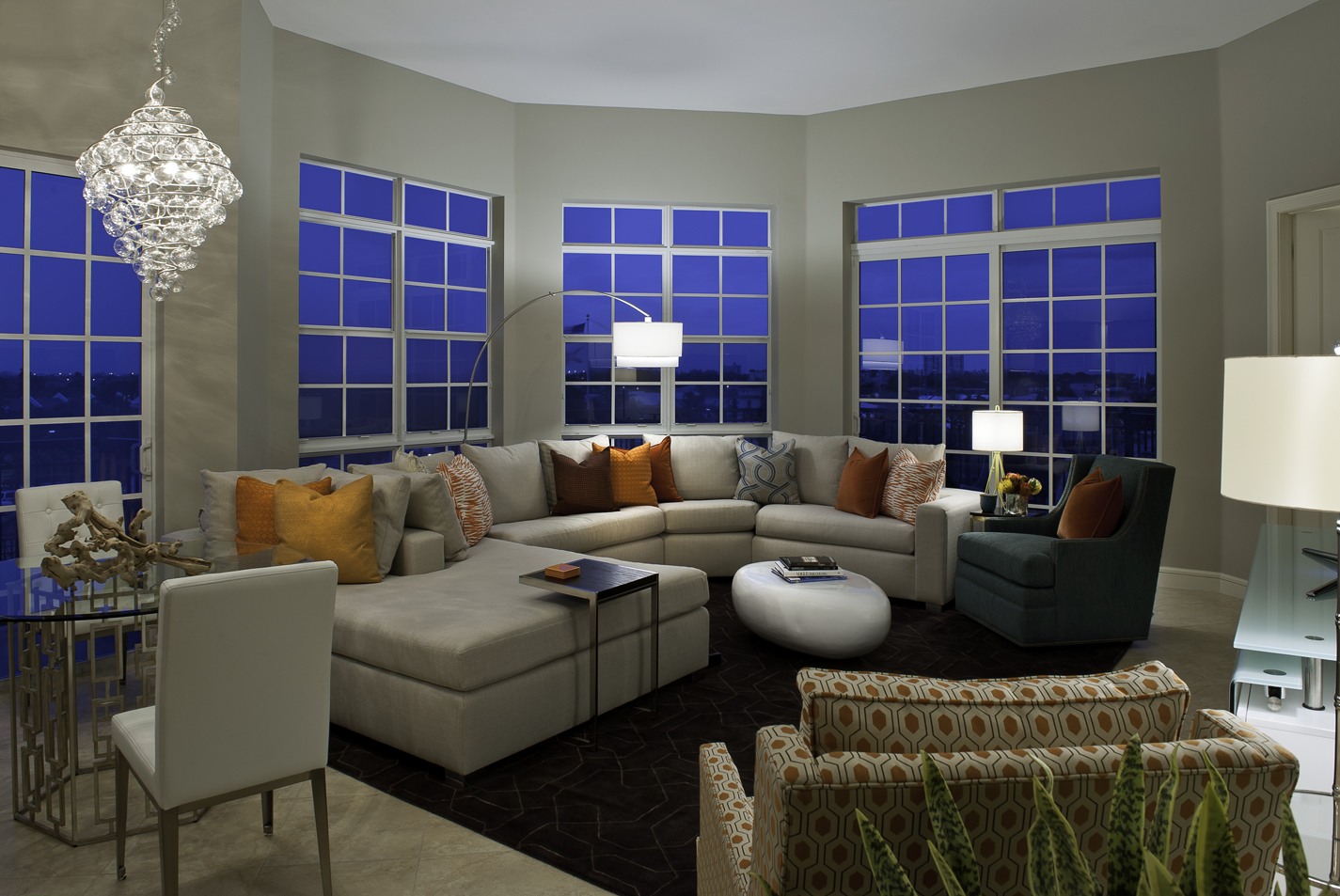 miami condo living room, custom sectional couch with custom pillows, splashes of color