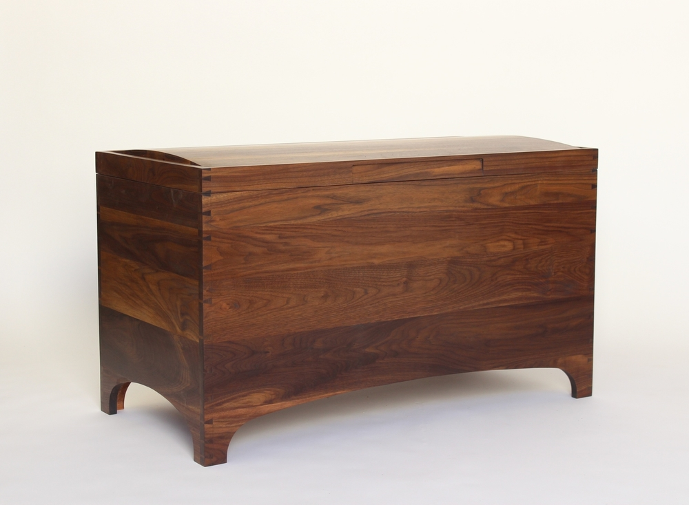 The gentle curve of the panel top reflects the lower curves to humanize the chest.