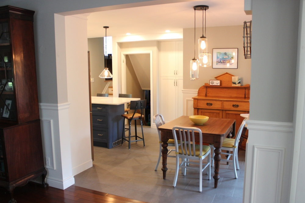 Looking into the kitchen space, you can see the pairing of old antiques, with a brand new kitchen. They look great together!