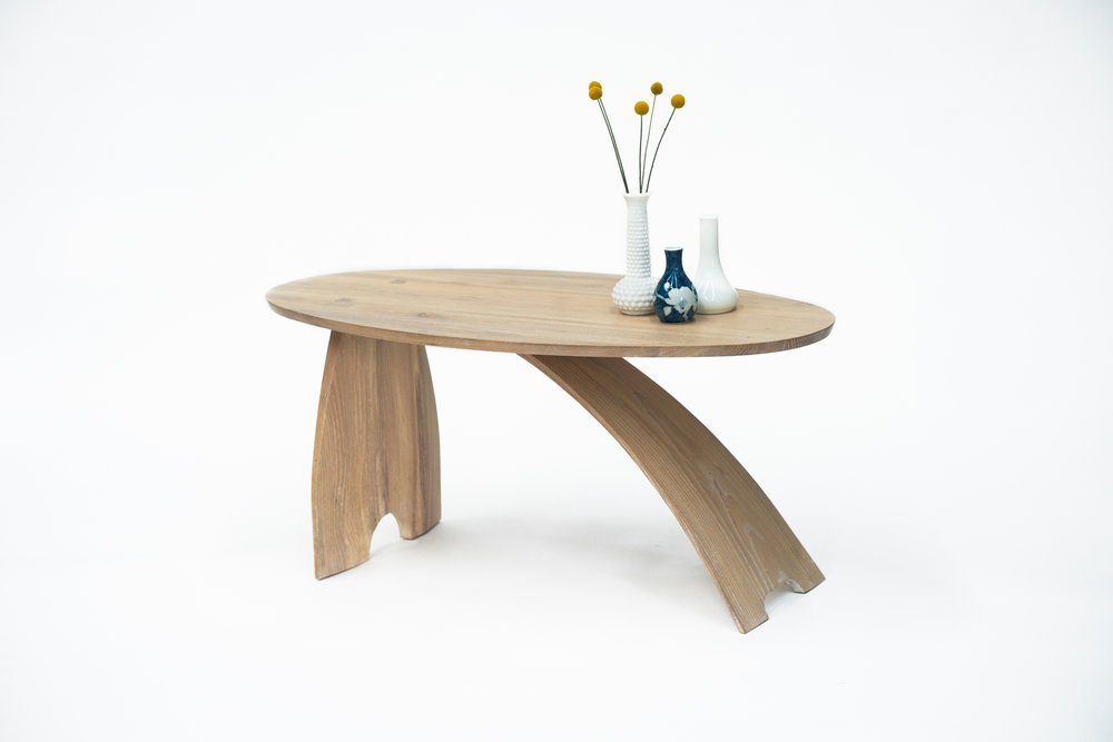 An asymmetric coffee table with two legs