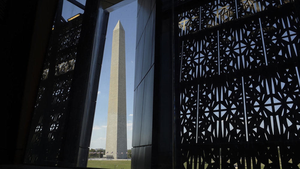 "A VIEW OF THE WASHINGTON MONUMENT. Through a ""lens"" in the architectural facade, visitors can see the Washington Monument on the Mall, and Arlington National Cemetery.   Photo credit:  Susan Walsh / Associated Press"