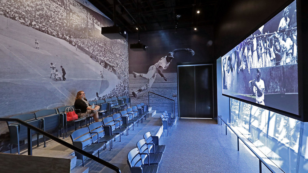 BASEBALL THEATER.   The chairs in this theater and recreated from a Negro League stadium – Negro Leagues were among the most important businesses in black America during the first half of the 20th century.    Photo credit:  Chip Somodevilla / Getty Images