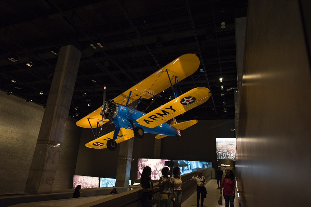 TUSKEGEE AIRPLANE. Overhead is the PT-13D Stearman Kaydet training aircraft used by the Tuskegee Airmen.    Photo credit: Luka Kito