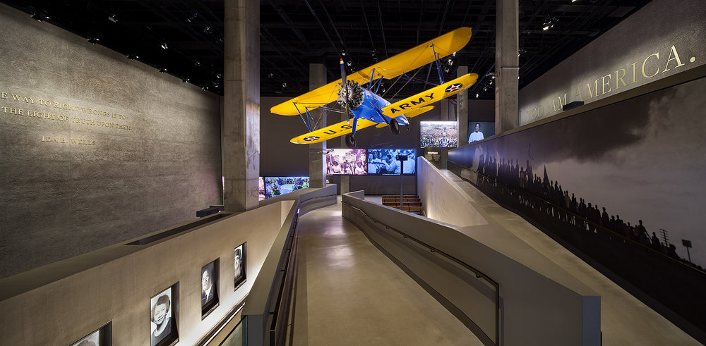 VIEW OF THE TUSKEGEE AIRPLANE, LANDING THEATERS, AND RAMPS FROM  THE ERA OF SEGREGATION  GALLERY.   Photo credit: Ron Blunt