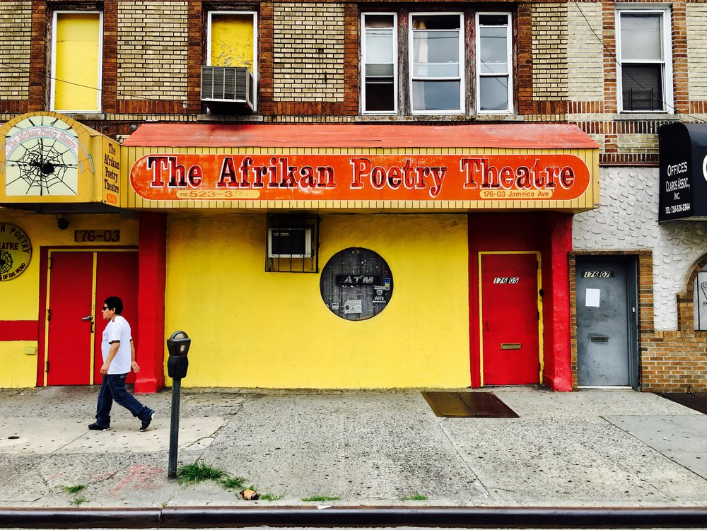 "Established in 1976 by co-founders John Watusi Branch and Yusef Waliyaya, the theatre has been stationed at its current location, 176th Street & Jamaica Avenue, since 1979. Yusef Waliyaya and the late John Watusi Branch, in 1976 as a collection of poets, singers and musicians focused on jazz, funk, African rhythms and poetry. The Afrikan Poetry Theatre was incorporated in 1977 and found a home on Merrick Boulevard the following year. It moved to its current location, at 176-03 Jamaica Ave., in 1979. .On November 5, 2006, the theatre celebrated its thirtieth anniversary, where Queens Borough President, Helen Marshall declared the day ""Afrikan Poetry Theatre"" day. On June 25 of 2016, the intersection of Jamaica Avenue and 176th Street in Jamaica, Queens was named John Watusi Branch Way. Words via Wikipedia photo by Adolfo Steve Vazquez"