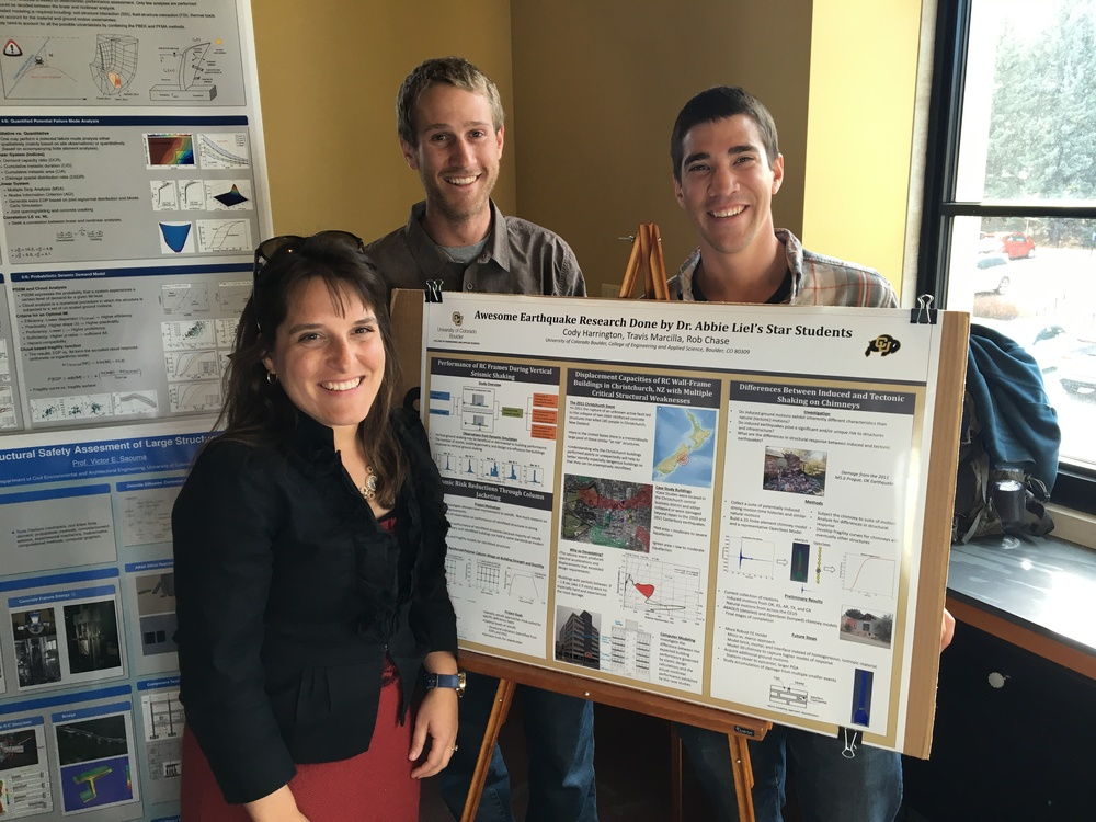 Abbie, Cody Harrington and Robert Chase, with Cody, Rob and Travis' poster at the poster session for visiting students.