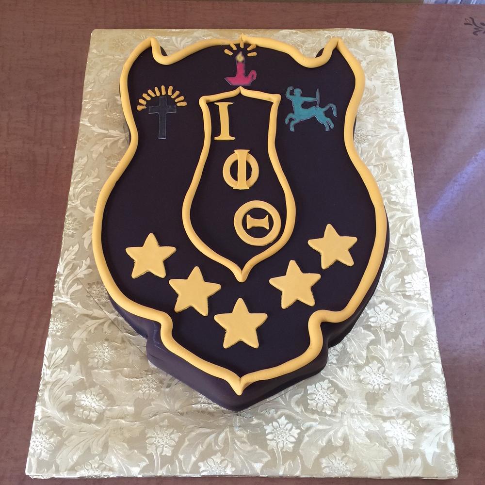 IOTAPHITHETA shield cake.jpg