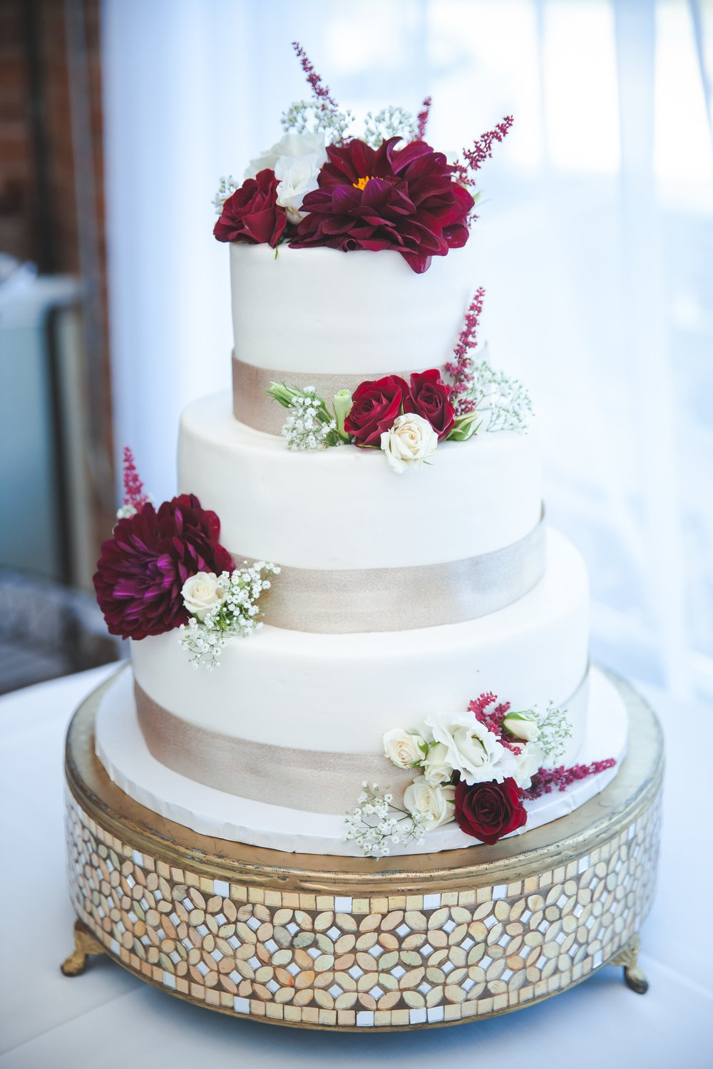 gold ribbon and purple flowers and roses- Danae and Hugh 1.jpg