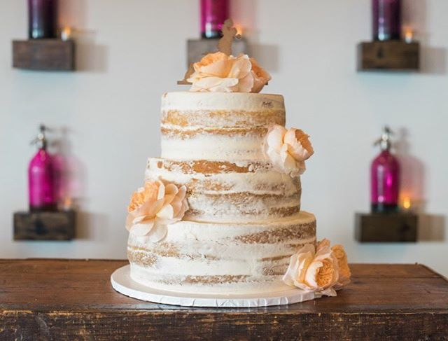 A perfectly smooth barely naked cake with delicate floral accents.  #weddingcakes #cakesatlanta #cakesmarietta #weddingcakesatlanta #confectionperfection #wedding 📷:@lindathreadgillphoto