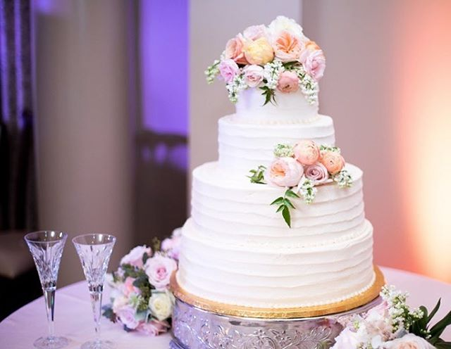 One of many beautiful photos from a wedding in May. A gorgeous four tier buttercream and floral cake. Congratulations to the happy couple, and congratulations to all of those celebrating this wedding season!  www.confectionperfectioncakes.com copyright Alyssa Alig Photography 2017 www.alyssaalig.com  #weddingcake #weddings #confectionperfection #cakesatlanta #cakesmarietta #weddingseason #cake #beautifulcakes